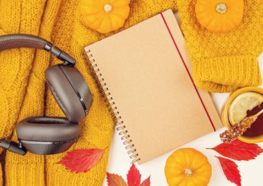 Flat lay autumn composition with fall leaves, hot cup of tea and