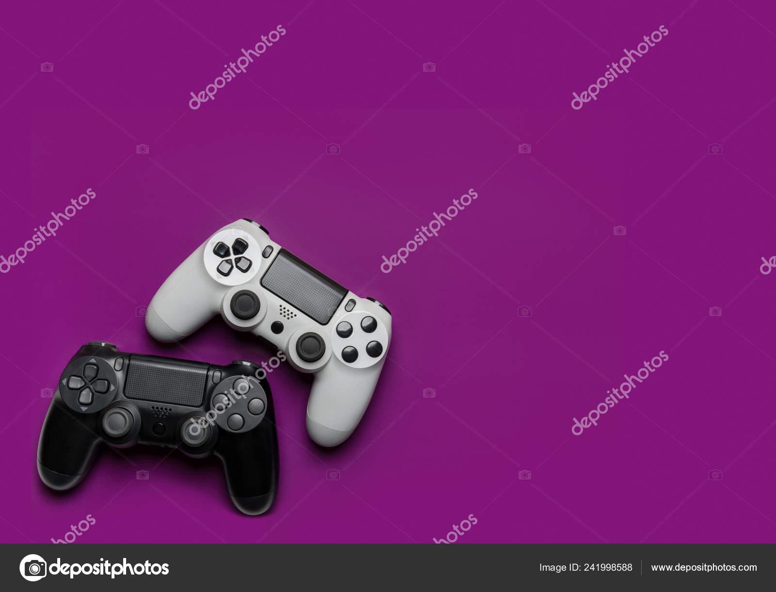 depositphotos 241998588 stock photo black white gamepads purple background