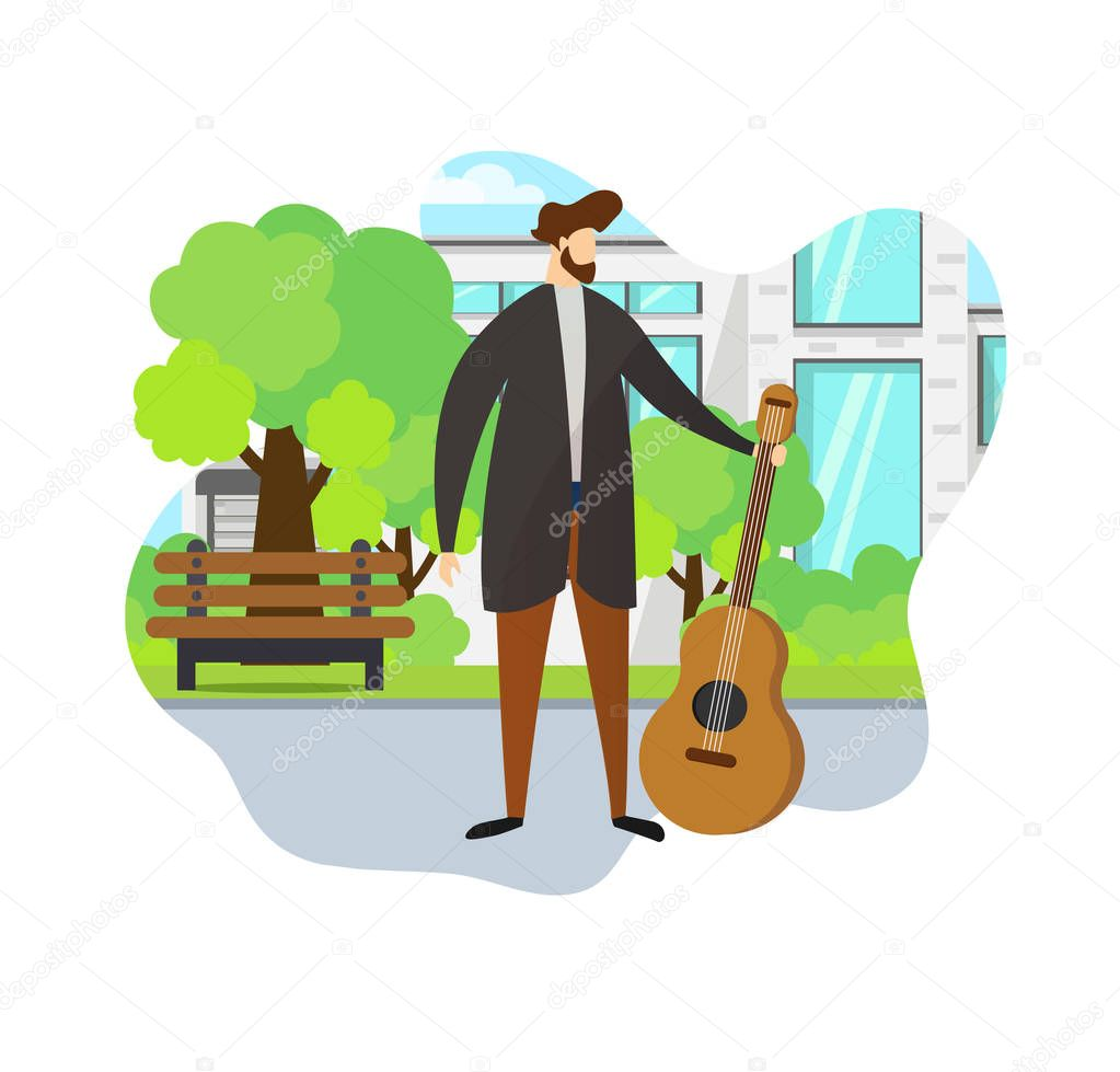 Stylish Man Holding Acoustic Guitar in Hand. Park.