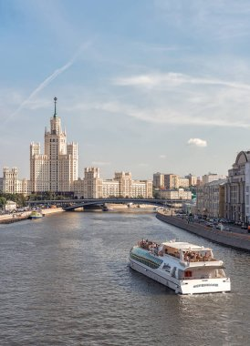 The ship of the Radisson flotilla and the skyscraper on the Kotelnicheskaya embankment. Russia, Moscow. September 9, 2017