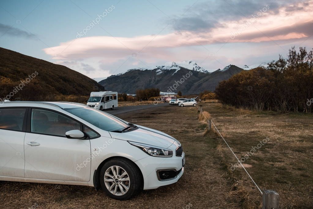 Parked vehicles at campsite in Nordic mountains landscape in Iceland stock vector