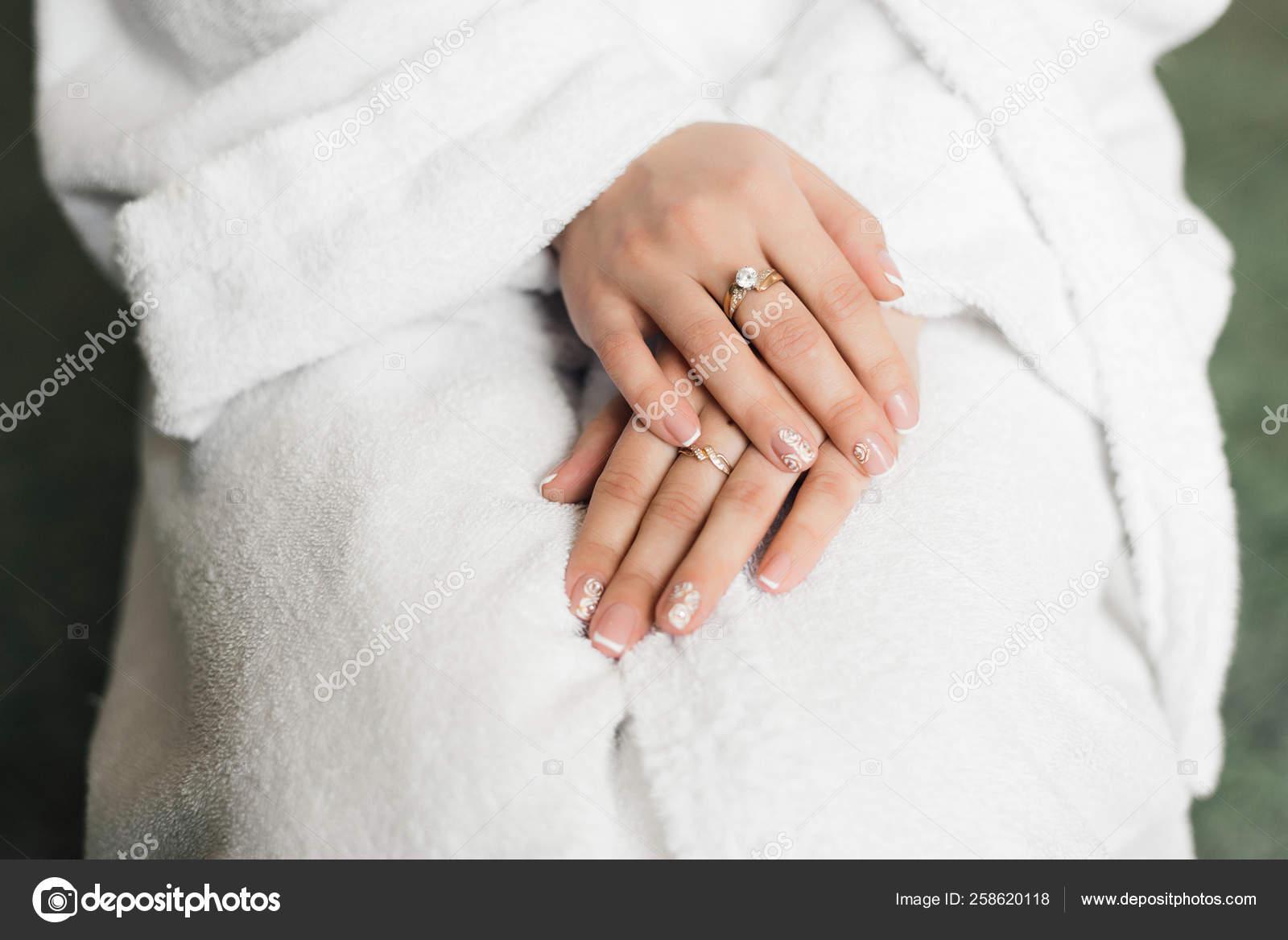 Bride Sits Bathrobe Her Arms Folded Her Lap Wedding Ring Stock Photo C Evgenyrukavitsyn 258620118