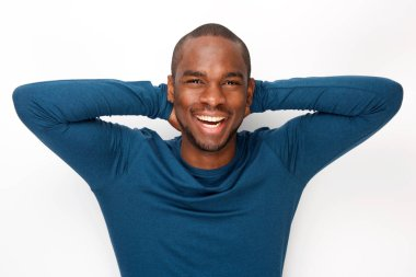 Portrait of cheerful young black man posing with hands behind head against white background