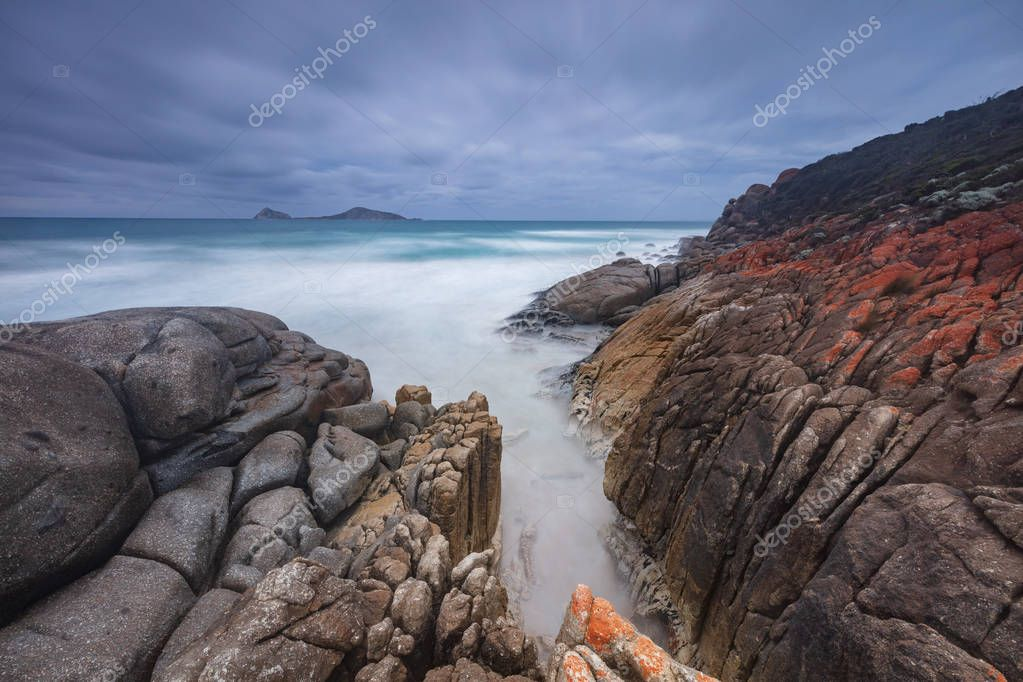 Dramatic and stormy day captured during a long exposure at Whisky bay beach in Wilsons Promontory national park, Victoria, Australia