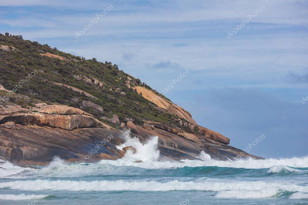 Waves crashing against the rock formations at Squeaky beach in Wilsons Promontory national park in Victoria, Australia
