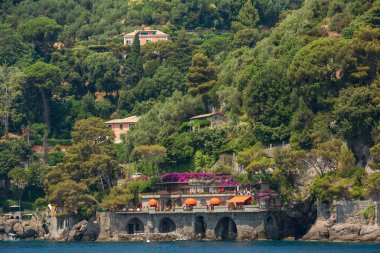 Portofino Italy July 6th 2015 : Buildings on the cliffs overlooking the beautiful harbour at Portofino on the  Ligurian coast, Italy