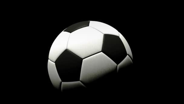 Fotbalový míč se otáčí na černém pozadí. prostorové vykreslování