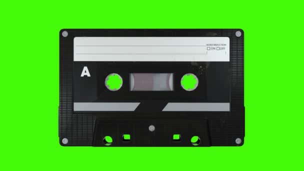 Old Audio kazeta točit na zelené obrazovce. 4K