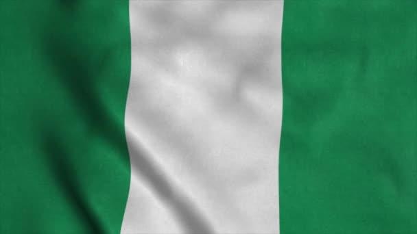Nigeria flag waving in the wind. National flag of Nigeria. Sign of Nigeria seamless loop animation. 4K