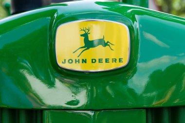 ST. PAUL, MN/USA - AUGUST 29, 2018: Vintage John Deere tractor trademark and logo. John Deere is the brand name of Deere & Company.