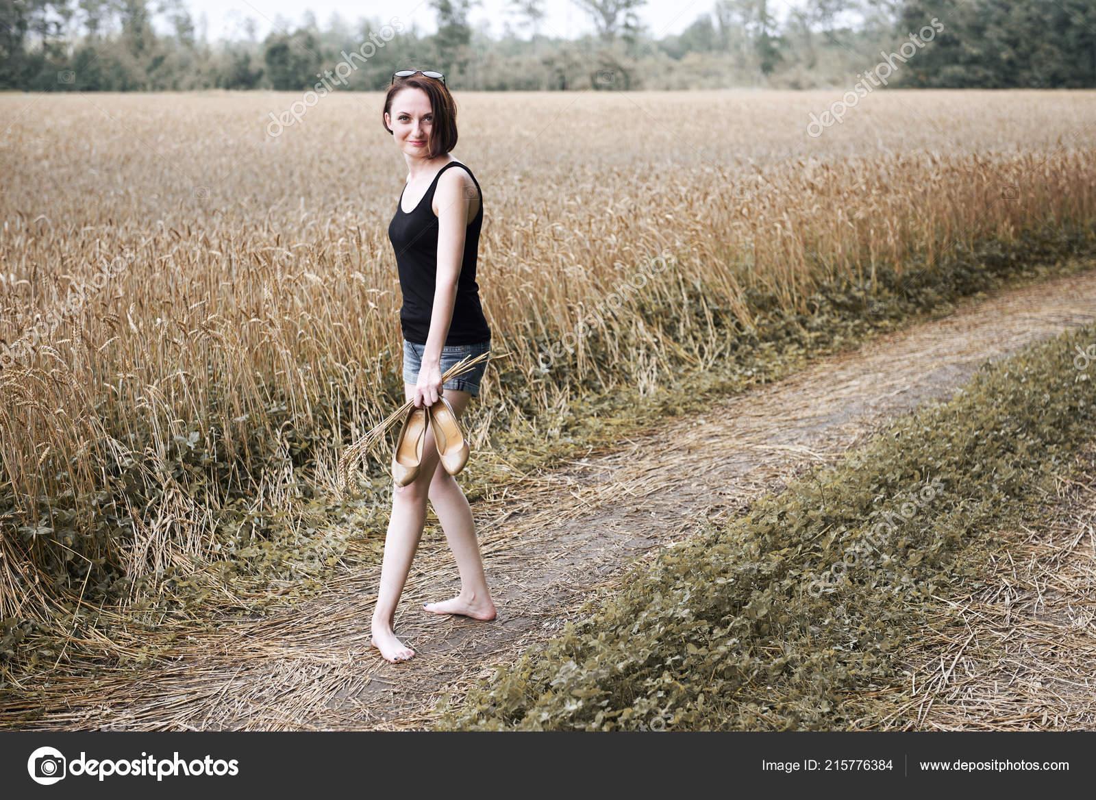 https://st4.depositphotos.com/1719616/21577/i/1600/depositphotos_215776384-stock-photo-young-girl-walking-barefoot-ground.jpg