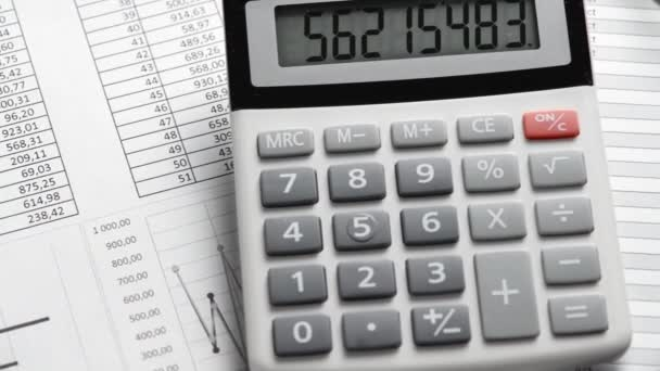 Calculator and reports closeup. Office supplies for working and calculating finance. Business financial accounting concept.