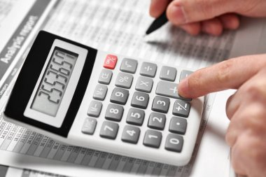 Businessman working and calculating finance. Business financial accounting concept. Closeup hands.