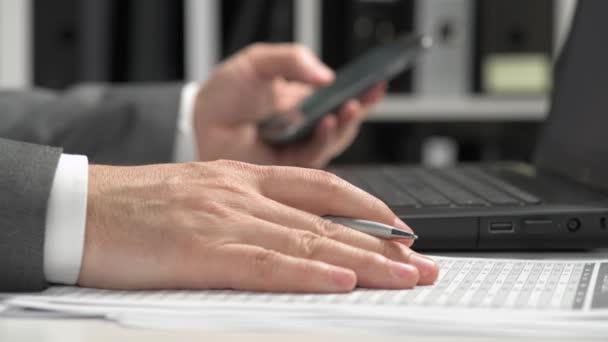 Businessman working in an office and using smartphone and laptop. Business financial accounting concept.