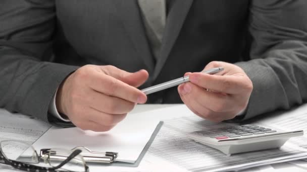 Businessman thinks about what to write. He working and calculating finance. Business financial accounting concept. Closeup hands.