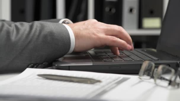 Businessman working and calculating finance. He reads and writes reports. Business financial accounting concept. Closeup hands.