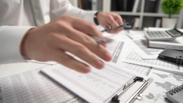 Businessman working at office and calculating finance, reads and writes reports. Business financial accounting concept.