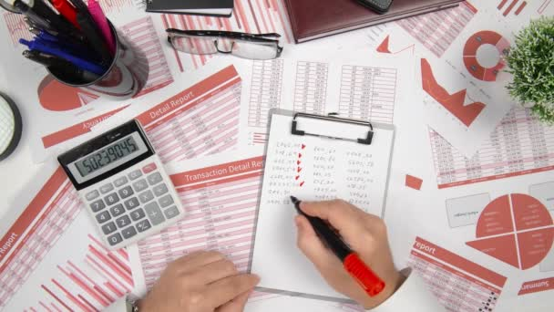 Directly above view of businessman working and calculating finance, reads and writes reports. Business financial accounting concept.