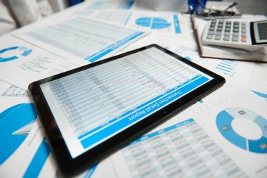 Office workspace for business. Tablet pc and reports. Table closeup. Business financial accounting concept.