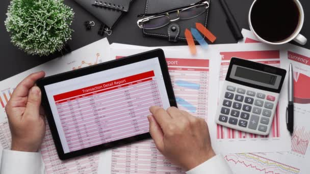 Top view of businessman working with financial statements. Modern black office desk with notebook, calc, pen and a lot of things. Flat lay table layout.