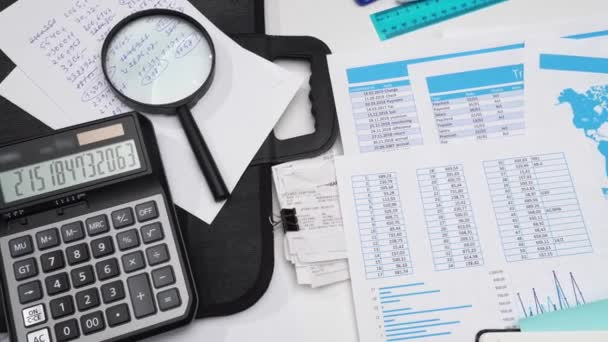 view of business office workplace desk closeup - financial spreadshets and reports with data for analysis and accounting, set of documents, various items for bookkeeping