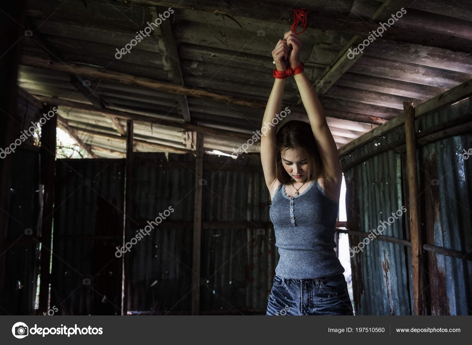 Depress Beautiful Asian Girl Tied Hands Red Rope Dirty Roof  Stock Photo -5009