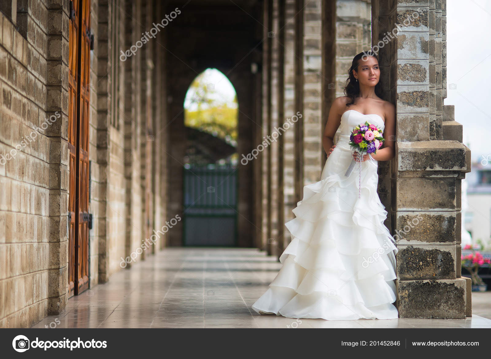 Bride Stands Gallery Stone Walls Beautiful White Wedding Dress Bouquet Stock Photo: Beautiful Stone Wedding Dress At Websimilar.org