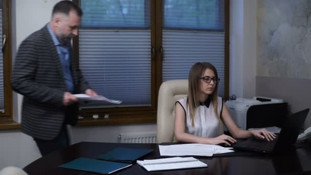 Angry boss scolds the employee, accuses an error in the report, poor performance, accuses of incompetence