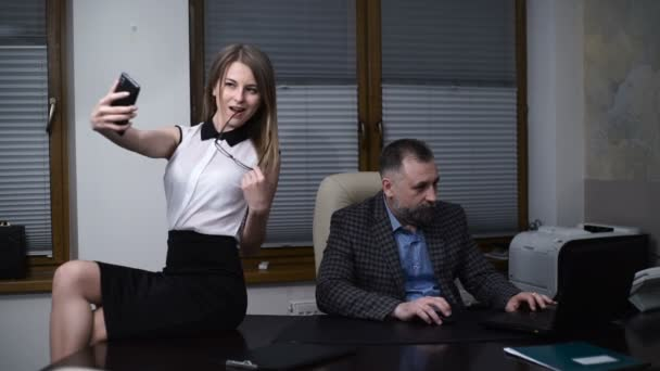 Secretary Makes A Selfie On The Desktop Of Boss While He Works On