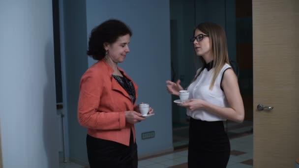 Women communicate during a coffee break