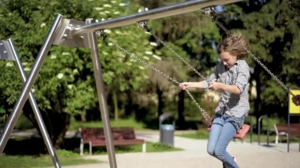 Children on swings at playground