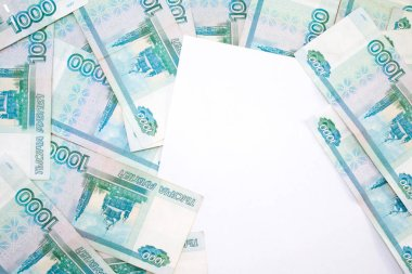 business, finance, saving, banking and people concept - close up bundle of money Russian Banknotes thousand rubles with free white space for text