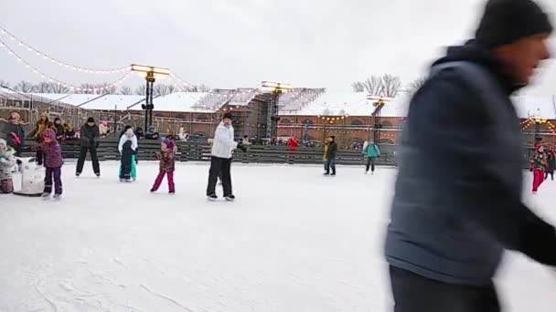 St.Petersburg Russia - 01jan2019: A crowd of people skating on the ice rink on the New Year holidays. Children learn to skate. The concept of active family rest holydays.