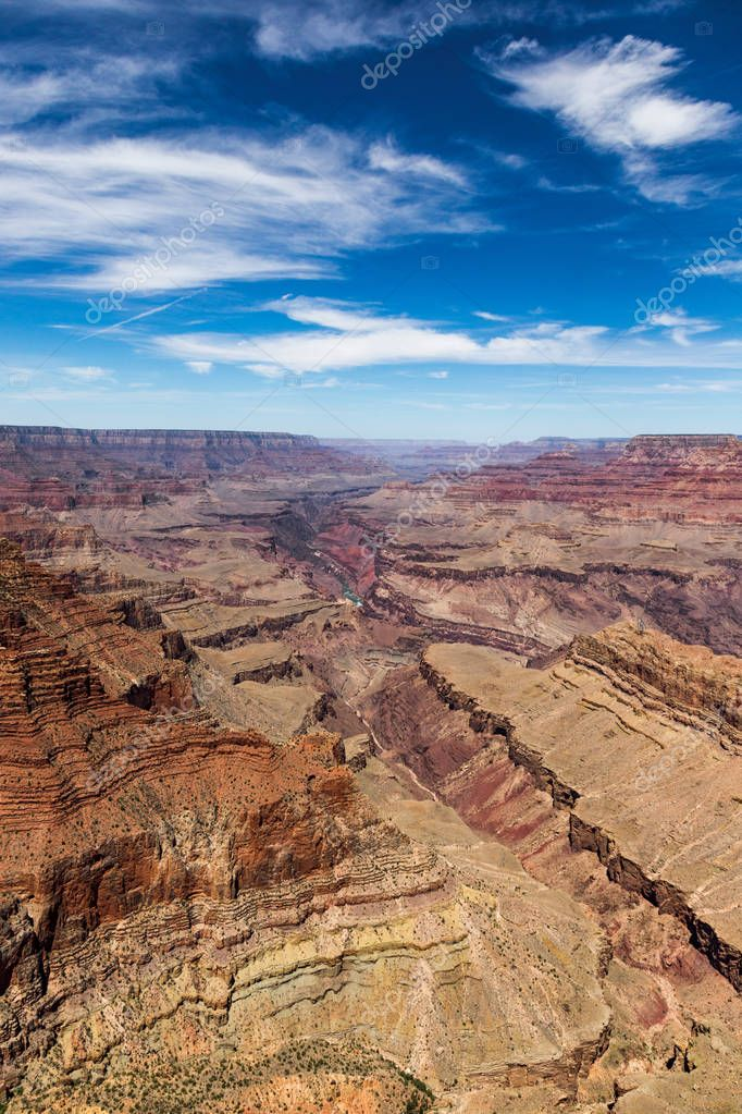 South Rim Grand Canyon carved by the Colorado River in Arizona, has layered bands of red rock revealing millions of years of geological history. View points include Mather Point, Yavapai Observation Station and architect Mary Colters Lookout Studio