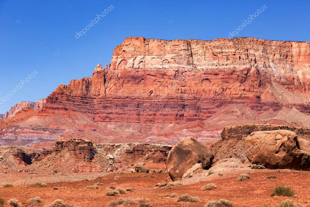 The Vermilion Cliffs are steep eroded escarpments consisting primarily of sandstone, siltstone, limestone, and shale which rise as much as 3,000 feet  above their bases. These sedimentary rocks have been deeply eroded for millions of years, exposing