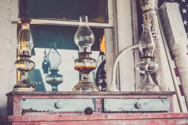 Glass Oil Lamp on Vintage Wooden Chest of Drawers