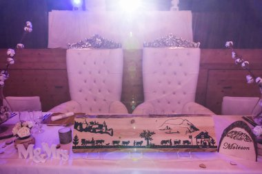 Bride and Groom Wedding Seats and Wedding Table in Pink Light
