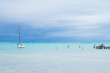 Small White Boat, Mooring Posts and Overcast Caribbean Sea