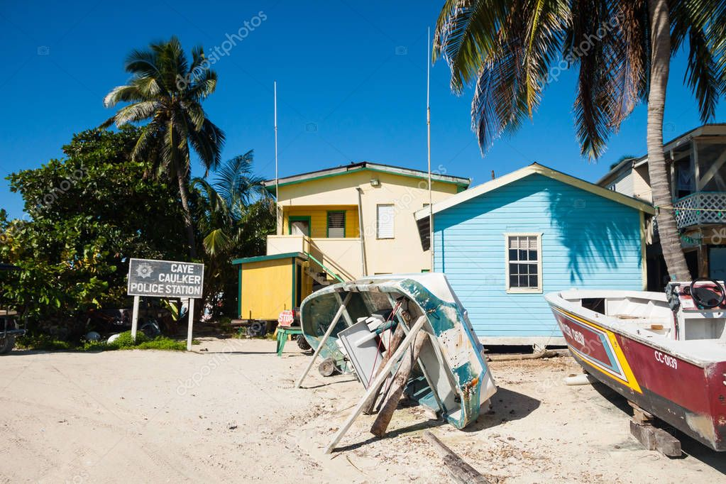 Upside Down Boats and Palm Trees in front of Caye Caulker Police Station
