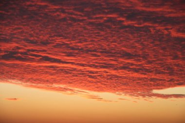 Dramatic Volcanic Crimson Sunset over Pacific Ocean