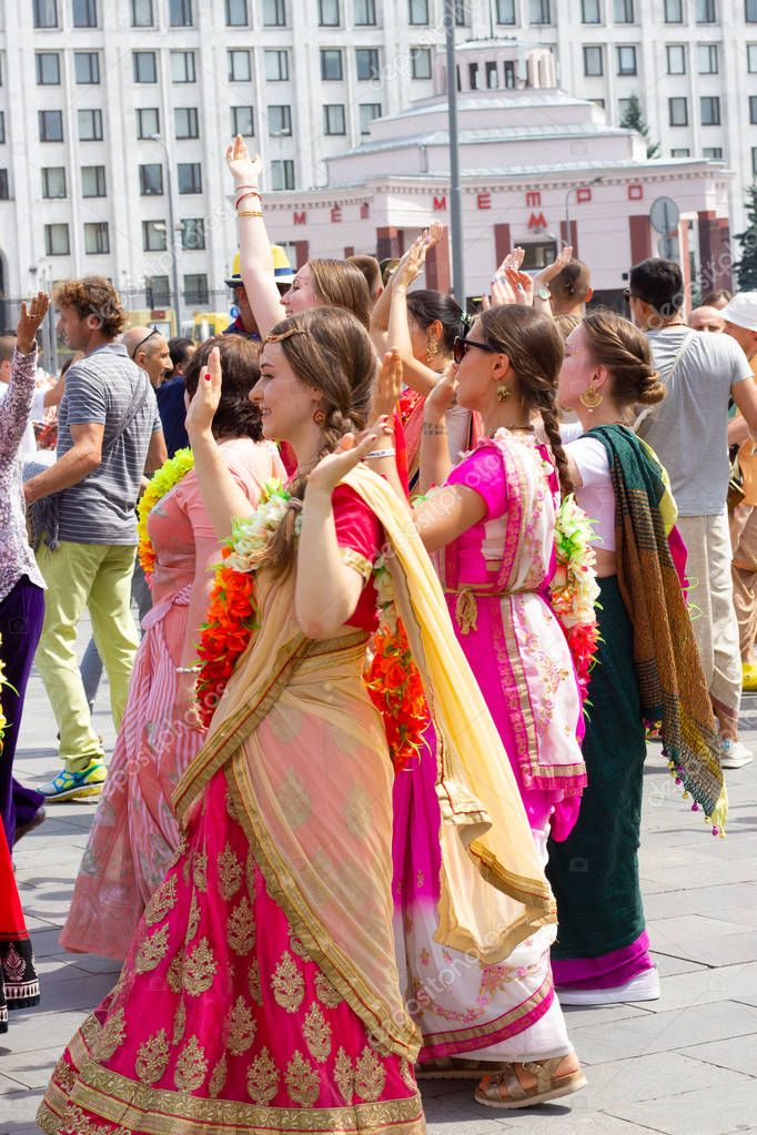 MOSCOW, RUSSIA- JULY 4: Devotees from Hare Krishna dancing with carnival revelers during the Vaishnava religious festival on New Arbat street on June 04, 2018 in Moscow, Russia