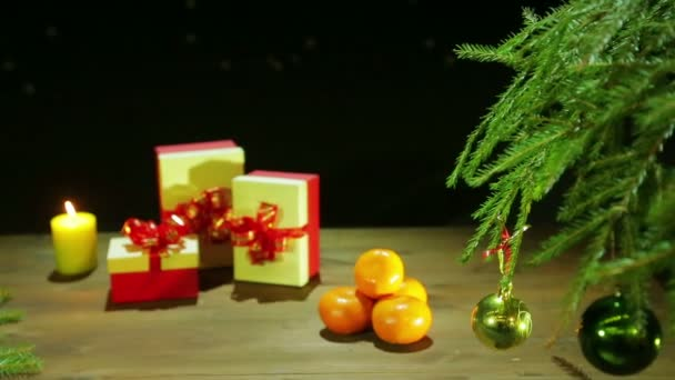 Christmas boxes by candlelight next to the Christmas tree