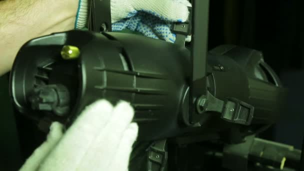 Illuminator in gloves works with a profile theatrical searchlight