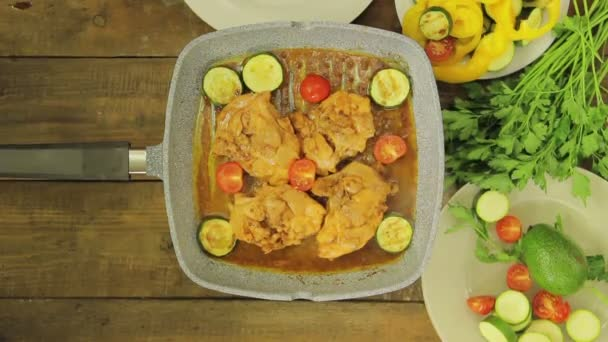 Female hand stirring vegetables and chicken in a grill pan. Time laps