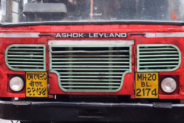 Translation: The red local public bus in Aurangabad, on the way to Ajanta or Ellora Caves.