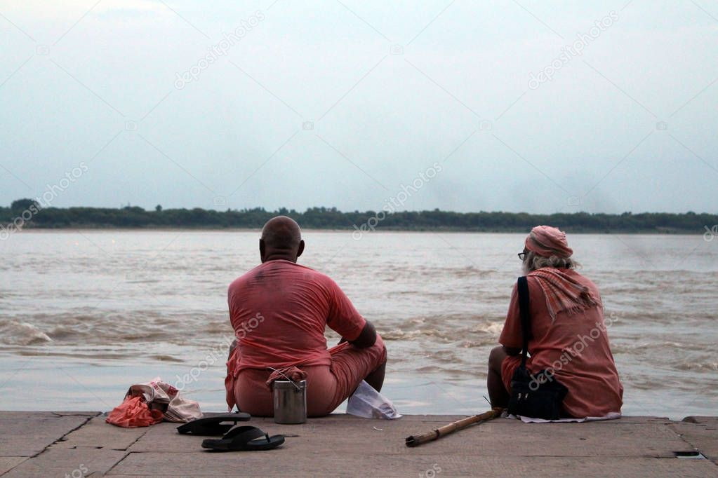 Local people chatting, interacting, hanging around Varanasi ghats in the afternoon. Taken in India, August 2018.