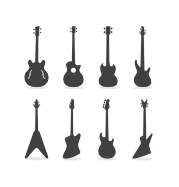 Silhouette Of Acoustic Semi-Acoustic And Electric Bass Guitars