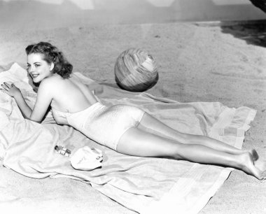 Woman lying on a towel at the beach