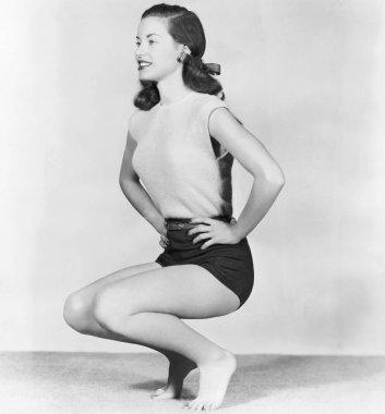 Woman doing deep knee bends