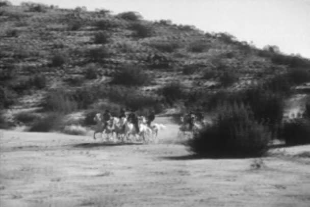 Group of men riding white horses on prairie, 1930s